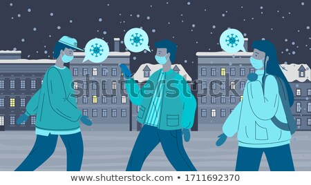 Young women break the rules of self-isolation and walking in the park in medical masks Stock photo © robuart