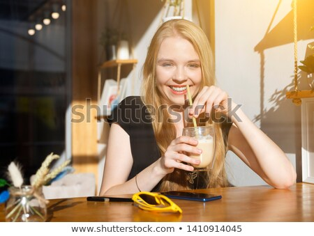Serious young girl with dreadlocks drinking coffee. Stock photo © deandrobot