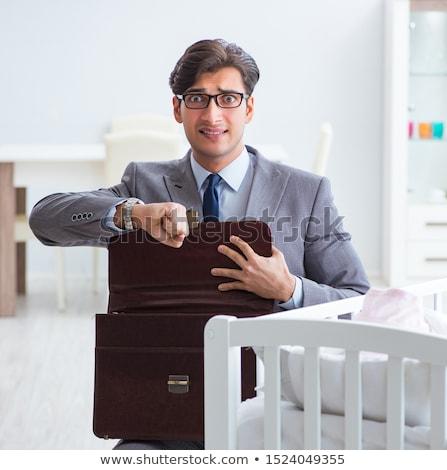 Jeunes affaires travailler à la maison bébé Photo stock © Elnur