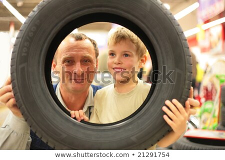 boy and man look into vehicle tire in store stock photo © paha_l