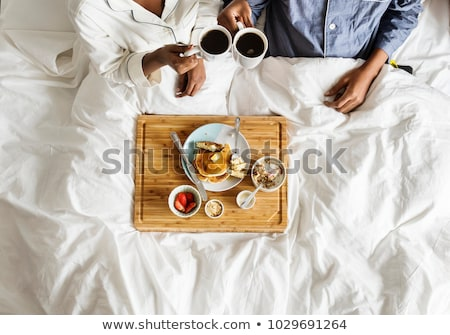 Couple relaxing at home on a Sunday morning Stock photo © photography33