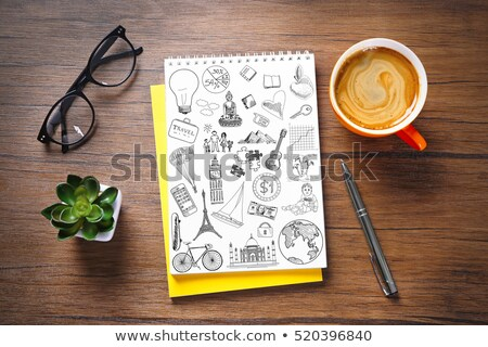 Sketchbook with coffee cup on wooden background Stock photo © Archipoch