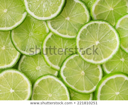 background of lime slices and green leaf stock photo © boroda