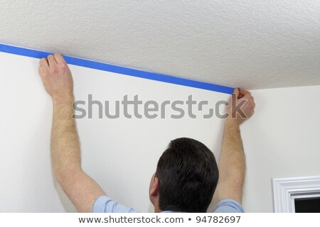 Man taping off wall Stock photo © photography33