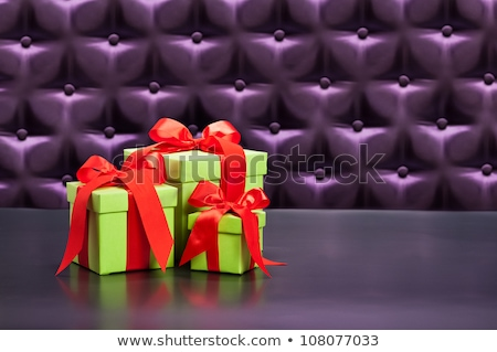 Gift or Present in front of a button tufted background Stock photo © 3523studio