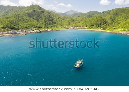 Mavi okyanus kırmızı deniz tekne Stok fotoğraf © timwege