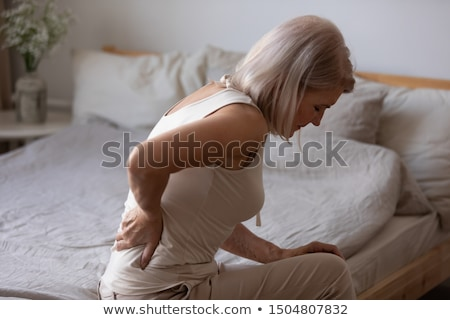 senior woman spine stretch stock photo © lisafx