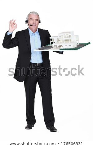 Grey-haired architect wearing telephone head-set Stock photo © photography33