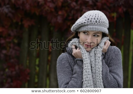 Woman wrapped up in a scarf and hat Stock photo © photography33
