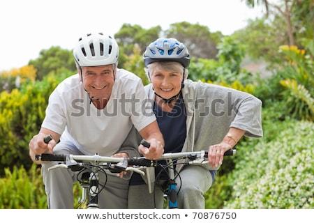 érett · pár · hegyikerékpározás · kívül · mosoly · hegy - stock fotó © wavebreak_media