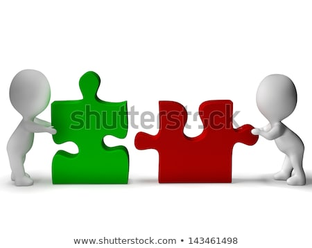 Jigsaw Pieces Being Joined Showing Teamwork And Assembling Stock photo © stuartmiles