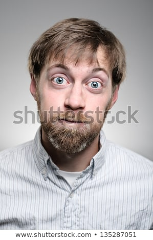 Young man is blowing cheeks stock photo © filipw
