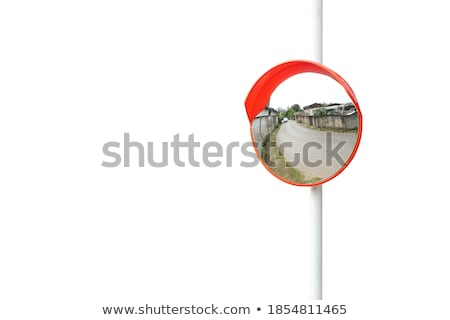 Isolated Curved corner traffic mirror on the roadside Stock photo © stevanovicigor
