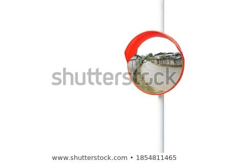 isolated curved corner traffic mirror on the roadside stock photo © stevanovicigor