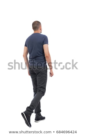 Handsome man in jeans standing back Stock photo © stockyimages