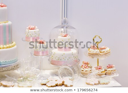 elegant sweet table with big cake cupcakes cake pops stock photo © dashapetrenko
