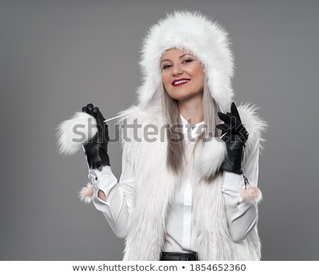 Cute Young Woman in Furry White Cap Stock photo © gromovataya