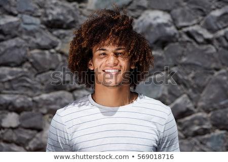 Sorridente homem cabelos cacheados sorrir cara Foto stock © deandrobot