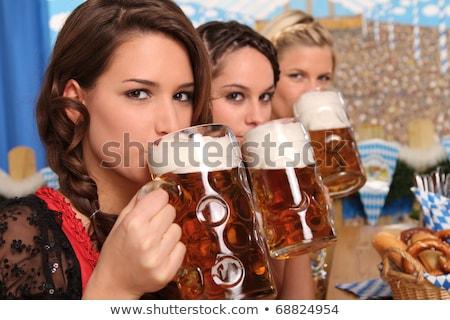 Oktoberfest kız içme sürahi bira beyaz Stok fotoğraf © wavebreak_media