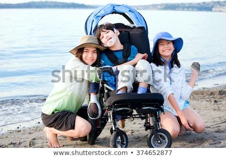 Mozgássérült gyermek tolószék kint tó család Stock fotó © jarenwicklund