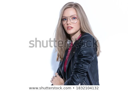 woman wearing glasses and smiling while arranging her hair Stock photo © feedough