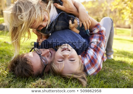 three children lying top view close up 2 stock photo © paha_l
