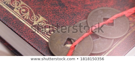 antique chinese book page and coin Stock photo © devon