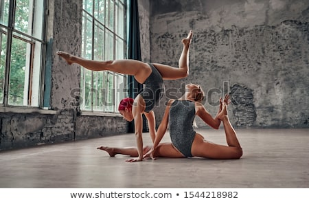 Gymnast girl sitting in twine Stock photo © svetography