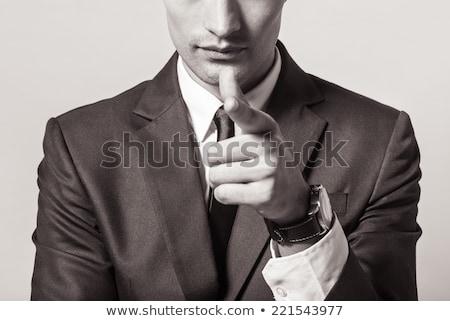 Adam siyah takım elbise yangın parmak nokta beyaz Stok fotoğraf © bank215