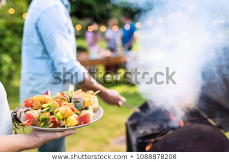 Young girl preparing food on grill Stock photo © vlad_star