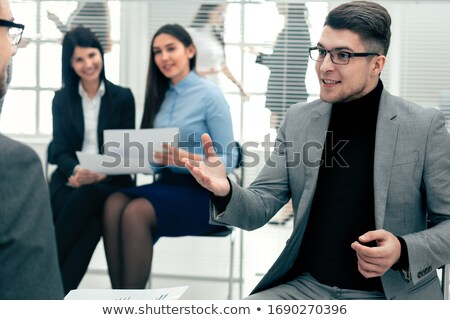 two happy young businessmen talking in office stock photo © deandrobot
