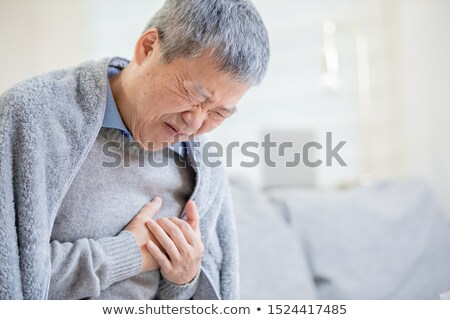 man suffering from sharp heartache chest pain. Heart disease Stock photo © ichiosea