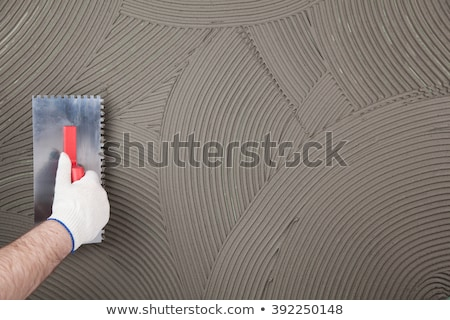 trowel in a man hand Stock photo © OleksandrO