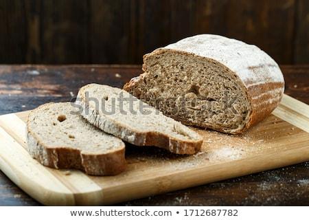sliced rye bread on a board on a wooden rustic table stock photo © yatsenko