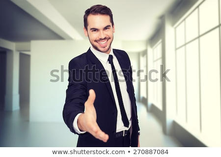 Modern business man with arm extended to handshake Stock photo © vlad_star
