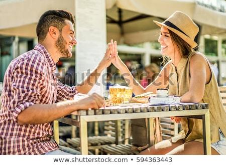 fidanzata · bacio · fidanzato · ristorante · primo · piano · sorridere - foto d'archivio © disobeyart
