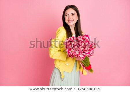 girl smiling holding flowers stock photo © is2