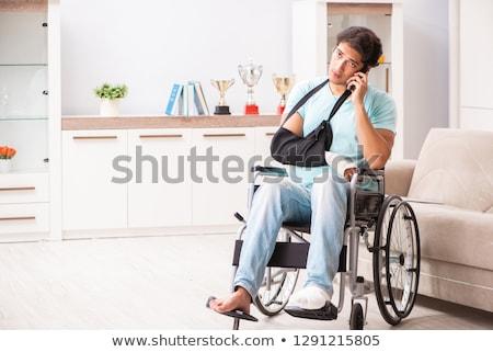 perna · quebrada · trauma · paciente · cadeira · de · rodas · hospital · masculino - foto stock © rastudio