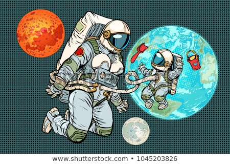 astronaut mother and child on planet earth humanity and the uni stock photo © studiostoks