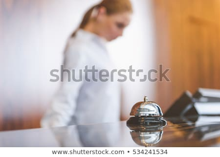 Close up of woman ringing a hotel porters bell Stock photo © IS2