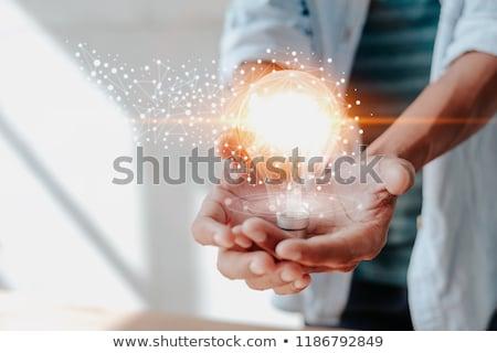 üzletember tart ötlet villanykörte befektető táblagép Stock fotó © studioworkstock