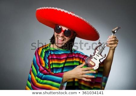 Uomo indossare sombrero chitarra party fase Foto d'archivio © Elnur