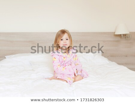 Family sitting on bed, portrait Stock photo © IS2