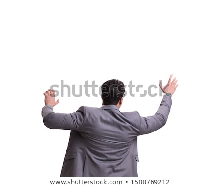 Businessman climbing virtual obstacle isolated on white Stock photo © Elnur