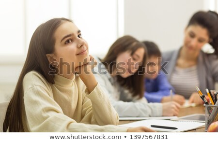 Girl daydreaming in classroom Stock photo © IS2
