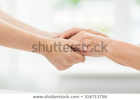 Starszy młoda kobieta ręce ludzi wiek Zdjęcia stock © dolgachov