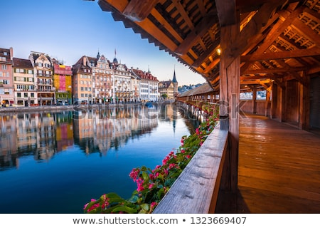 Luzern Chapel Bridge and waterfront landmarks view Stock photo © xbrchx