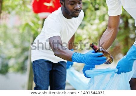 Bénévoles ordures sacs nettoyage parc bénévolat Photo stock © dolgachov