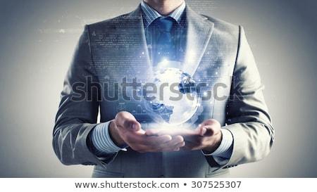 Zakenman hand aarde hologram business Stockfoto © dolgachov
