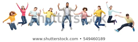 group of people or teenagers jumping stock photo © dolgachov